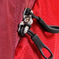 Panel zip access to main compartment with lockable zippers